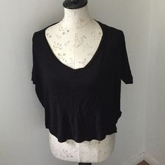 Black Crop Top Ladies black crop pull over top. Front is soft jersey type fabric & the back is a satin type fabric. Rayon & Polyester. Size S. Previously worn. Forever 21 Tops Crop Tops