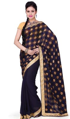 Be an icon of contemporary style wearing this navy blue shade brasso, chiffon and georgette saree. The interesting lace work a substantial feature of this attire. Upon request we can make round front/back neck and short 6 inches sleeves regular sari blouse also.  #ExquisiteNavyBlueBrassoGeorgetteChiffonSari