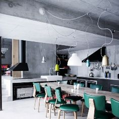 The clean lines of this home mixed with a good dose of quirky lighting and stylish furniture is a winner in my book.