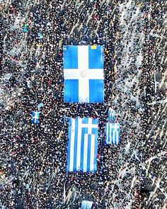 "Thousands of Greeks staged a mass rally in Athens Sunday, urging the government not to compromise in a festering name row with neighbouring FYROM. As a huge Greek flag flew over central Syntagma Square, Greeks from all over the country and abroad chanted ""Hands off Macedonia"", ""Macedonia is Greek"". Renowned Zorba the Greek composer Mikis Theodorakis was the keynote speaker despite battling health issues at 92."