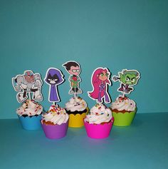 Teen Titans Inspired Cupcake Toppers Set of 12 Cupcake Toppers D E S I G N: Assorted Characters shown professionally cut on card stock and attached to a premium cupcake pick. Images are double sided and can be enjoyed from all angles of the party table. C H O O S E: -12 Toppers Only -12 Toppers and 12 Matching Cupcake Wrappers (Not intended for baking but wrapping baked cupcakes) SIZE: Image is approx 2.75 - 3 inches tall T H E M E: Complete the theme with other matching party items (NOT ...