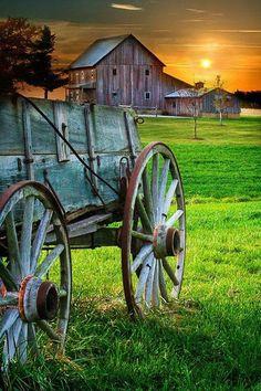 Old barn and wagon at sunset