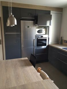 Faktum kitchen with abstrakt grey high gloss doors drawers for Cuisine ikea gloss