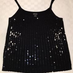 Black tank sweater dressy sequins large Beautiful black tank top with vertical lines of sequins by NY & Co. All of the sequins are in tact so you will sparkle in this hot number. 78% acrylic & 22% Nylon. Excellent condition. NY & Co Tops Tank Tops
