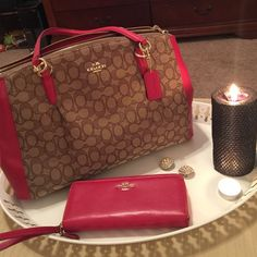 red hot red and tan coach purse Wristlet is a photo prop. I bought this on 11/06/15 but I don't care for it since I dress in yoga pants a lot. Not my style. I cut the tags and can't return it. There's nothing wrong with the bag, used it a day or so and took my things out to avoid damage. Coach Bags Shoulder Bags
