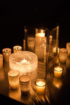 Patterned candle holders and a textured tea light bowl add texture to a glass lantern and simple votive candle holders.