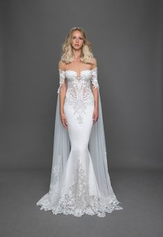 Fitted off-the-shoulder gown with sheer corset bodice with lace appliqués, crepe skirt, sheer back, train with lace insert. Removable cape sold separately. | Pnina Tornai | Style: 4630