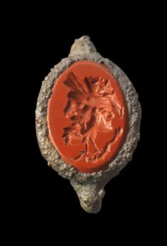 Iron ring with a gemstone of red jasper showing a gryllos. Roman, 2nd century A.D. Ring corroded.
