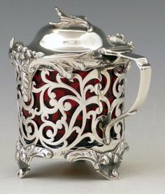 Silver mustard pot with open work sides and cranberry glass liner, Wm Hunter, London 1847, 4oz 10dwt.