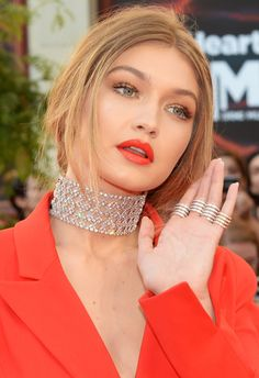 """Cosmopolitan - The Must-Steal Drugstore Secret Behind Gigi Hadid's PERFECT Summer Red Lip.  Makeup artist Patrick Ta created the lip by mixing together two shades from the Maybelline New York The Loaded Bolds collection, """"Smoking Red"""" ( a muted red lipstick to complement her non-toured cheeks) and """"Orange Danger,"""" to create the bespoke hue. Available online now, and in stores everywhere next month, the colors cost only $7.50 a pop and look equally lovely on their own (re: the taupe-y red..."""