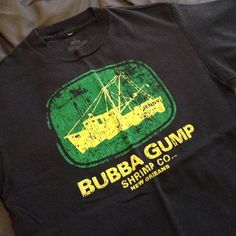 w/ any $25 purchase! Bubba Gump Shrimp Co. Tee Tee from Bubba Gump Shrimp Co. Black- tiny bit of fading from wear. Fuzzy decal- distress to decal is intentional and was purchased as such. EUC. FREE WITH ANY PURCHASE OF $25 OR MORE! Simply comment and let me know you are interested in adding this to your purchase. Tops Tees - Short Sleeve