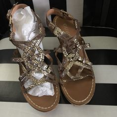 Yarkena Guess wedges These have been worn once || like new || size 6 TTS || gold & brown leather is very soft || same day shipping!! Thanks & have a great day!  Guess Shoes Wedges