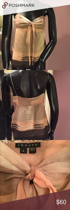 theory Lotis 💯 % Silk Spaghetti Strap Tank. theory  Lotis 💯 % Silk Spaghetti Strap Tank. Ties in the front. Gorgeous Tan, Peach and Brown woven in this dressy tank top. Fully lined. Straps are not adjustable. Excellent Used Condition! ❤️bundle and save ❤️ Offers Welcome! Theory Tops Tank Tops