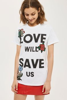 Make a bold statement with the 'Love Will Save Us' motif tee. In a basic white, it's also embellished with cartoon-style floral embroidery.