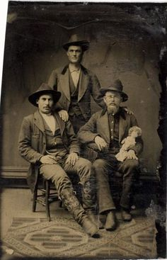 ca. 1875, [tintype portrait of three gentlemen, one with a doll]