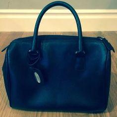 Furla Black Leather Handbag Furla black leather handbag. Lovingly used. No outside scratches or defects.  Perfect size.  Classic shape. Furla Bags