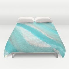 This lovely abstract ocean wave design in cool Calypso aqua might remind you of a lovely day under the waves. The duvet cover or comforter features a modern geometric design in soft beachy colors making it the perfect choice for your coastal decor bedroom. This image is a digital graphic design. I hope you enjoy the image!  Duvet Cover does not include duvet  Message shop owner for international shipping options  Pillow case: coming soon Throw pillow also available…