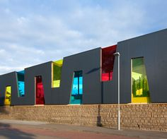 School yard Pavillion in Rodange, Luxembourg by Holweck Bingen Architects - colorful windows - influence on child's mood?