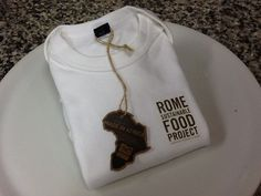 Infants'wear  You can buy it during Pasta Book Presentation Saturday, November 23 at AARome with all proceeds going to support the Rome Sustainable Food Project. www.aarome.org