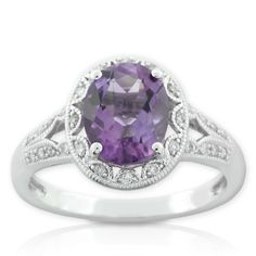 Amethyst ring with 1/7 carat total weight of diamonds, in 14K white gold.