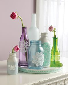 Put the perfect finishing touch on colored glass jars and bottles by embellishing them with delicate doilies and other lacy accents. Click for the DIY!
