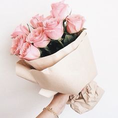 Pink roses (and peonies) in brown paper remind me of my nana, who passed 10 yrs ago. They aren\'t my favourite, but they were hers - and that\'s better, because having them around means I get to hear the echo of her voice in my head, \