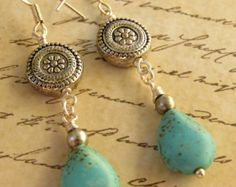 Boho Earrings - Silver earriing, dangle earring,Turquoise earring. Green Blue Picasso Czech bead with larger turquoise Czech bead and silver spacers on Silver earwire. These are about 1 1/2 in long without the wire. The Czech turquoise bead is about 7/8  long and about 1/3 wide. These are medium weight.  Bohemia, a part of the Czech Republic (formerly part of Czechoslovakia, formerly part of the Austro-Hungarian Empire), became famous for its beautiful and colourful glass durin...