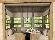 rustic banquet seating | Rustic breakfast nook with built in banquet seating with two wicker ...