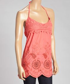 Woven with wonders and wanderlust, this simply sweet halter is sure to make a bold boho statement. The crochet and embroidered cutout combination adds flower-child flair to this cool cotton top.