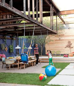 The courtyard is an extension of this renovated Toronto dairy, with a big table that hosts parties, a stage for impromptu performances, and part of an old loft overhead that will one day become a treehouse for the children.