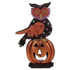 """Iron owl figurine atop a smiling jack-o'-lantern.  Product: FigurineConstruction Material: IronColor: Orange and blackDimensions: 20"""" H x 11"""" W x 4"""" DNote: Guaranteed delivery by Halloween"""