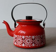 Vintage Red Enamel Finel Arabia kettle / teapot by Kaj Franck and Raija Uosikkinen - Punahilkka Punahilkka seems to translate as Red Riding Hood, while Sinihilkka translates as Blue Bonnet. So, a fairy tale inspired pattern?
