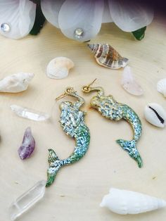 A personal favorite from my Etsy shop https://www.etsy.com/listing/252434722/large-gold-sparkle-mermaid-earrings