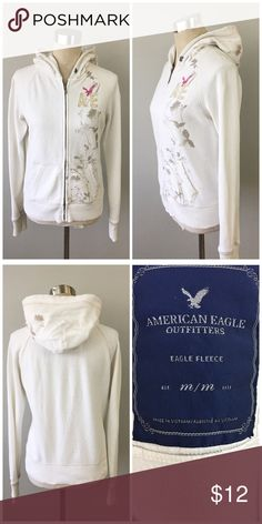 American Eagle White Printed Zip Up Hoodie American Eagle White Printed Zip Up Hoodie. Size medium. Thank you for looking at my listing. Please feel free to comment with any questions (no trades/modeling).  •Condition: GUC, no holes or stains.   ✨Bundle and save!✨10% off 2 items, 20% off 3 items & 30% off 5+ items! FC American Eagle Outfitters Tops Sweatshirts & Hoodies