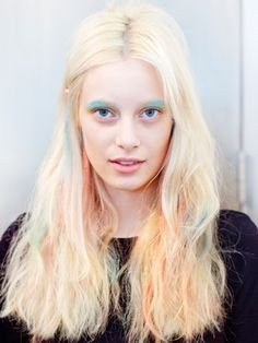 Best Beauty Looks from NYFW Spring 2013: It's baaaaack... rainbow hair, that is. Peter Som kept his version of the candy-colored trend messy and distressed this season. Playful pastel eyeshadows served as the finishing touch to this Crayola-bright beauty look.