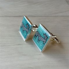 Strictly one-of-a-kind cufflinks! These high quality silver-plated 20mm square cufflinks are made with two Irish vintage stamp designs from the 1970ss with a Celtic stylized deer design on a turquoise background...   These were issued between 1974 and 1980 in Ireland, and cost 9 (old) pence.    Thanks to a stamp collector friend , l have more beautiful genuine vintage stamps to play with!- mostly from England, Scotland and Ireland.   lm told that cufflinks are back in fashion!  -Its nice to…