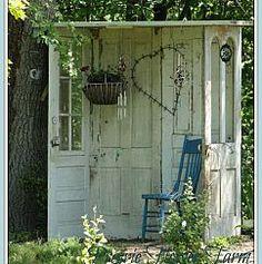 garden retreat made from old doors, how neat...