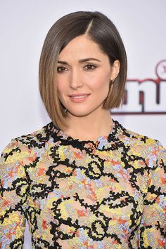 Byrne balances elegance and edge with her glossy chestnut tresses styled into an ultra-sleek bob parted to the side.   - ELLE.com