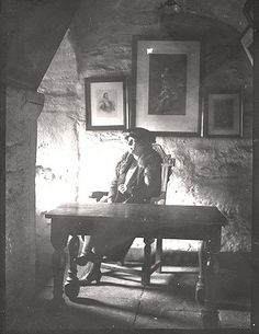 https://flic.kr/p/7dCBLf | 035643:Castle Keep Newcastle upon Tyne Unknown c.1910 | Type : Lantern Slide Description : A photograph of the interior of one of the rooms in the Castle Keep taken c.1910.  The view shows a woman sitting at a table in front of the window.  On the wall behind her there are three framed portraits.Castles Collection : Local Studies Printed Copy : If you would like a printed copy of this image please contact Newcastle Libraries www.newcastle.gov.uk/tlt quoting…