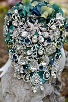 Vintage inspired teal and blue peacock brooch bouquet by Noaki $520