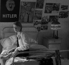 Inside a teenage girl's bedroom: wall decorated with posters of her idol. The left one was poster of 1932 election campaign.