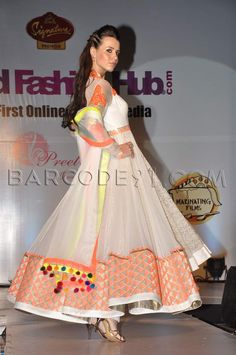 Orange, white, and gold anarkali.