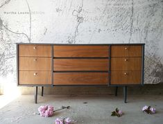 A mid century dresser by Martha Leone Design. Drawers were sanded to raw veneer then sealed with a satin poly. Casing and legs were painted in a custom gray.