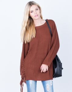 Every girl needs a rust piece in their closet, especially during the Fall season! Take our All Tied Up Sweater Dress with you into your weekend travels. Made from a textured chunky knit fabric giving
