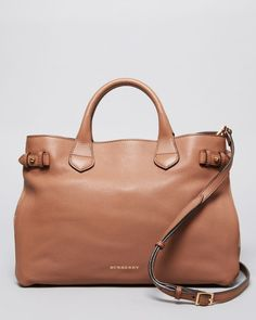 This Burberry tote is the perfect color for your spring wardrobe, and it never goes out of style.