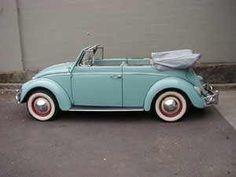 Antique aqua VW beetle convertible.cute!