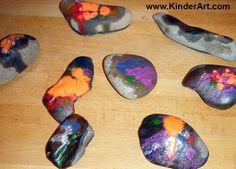 Melting crayons onto stones