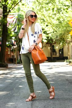 Browse the best summer street style outfit ideas at @stylecaster | @atlanticpacific blogger in star-print tee, cargo skinnies, tan accessories