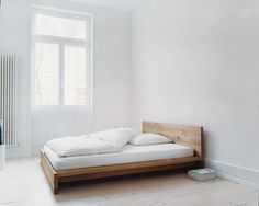 more or less this, but a platform bed. Maybe slightly darker/ cooler wood colouring. Solid Wood Bed Frame, Modern Minimalist, Chaise, Mo Design, Minimalism, Armchair, Beds, Cute Stuff, Quartos