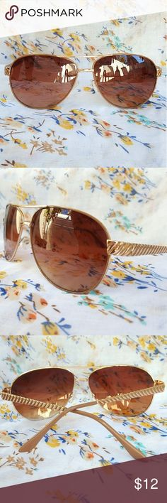 Aviator Fashion Sunglasses EUC Stylish gold metal frame sunglasses worn a few times, no noticeable wear. Amber gradient lenses free of scratches. 100% UV Protection. Charming Charlie Accessories Sunglasses